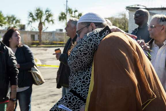 Josephine Soliz, city council member, hugs Imam Osama Hassan outside the Islamic Center of Victoria after people gathered to show support for the muslim community and pray on January 29, 2017 after the mosque burned in Victoria, Texas.