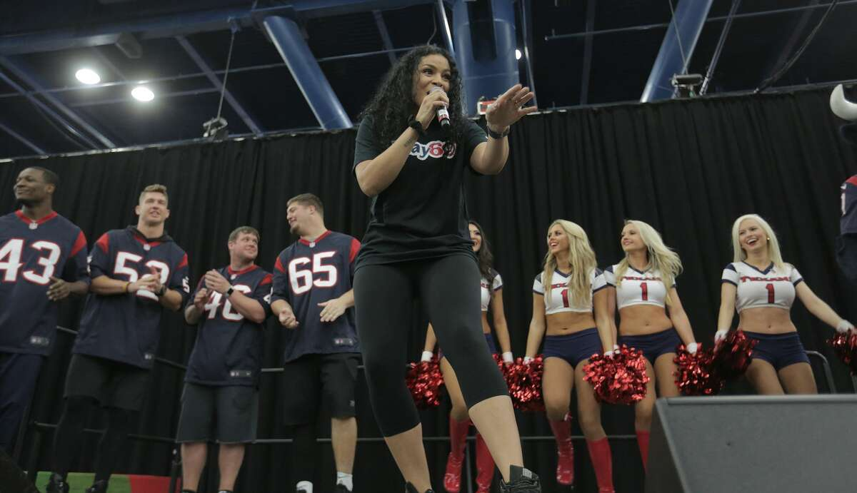 Jordin Sparks sings in front of cheerleaders and Texans during the NFL Play 60 Kids' Day on Wednesday, Feb. 1, 2017, in Houston.