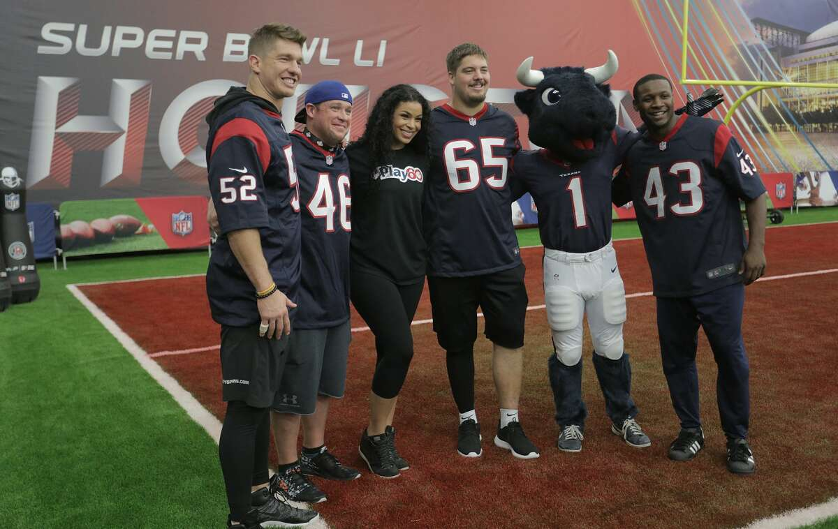 Jordin Sparks poses with members of the Houston Texans football team including mascot Toro during NFL Play 60 Kids' Day on Wednesday, Feb. 1, 2017, in Houston. ( Elizabeth Conley / Houston Chronicle )