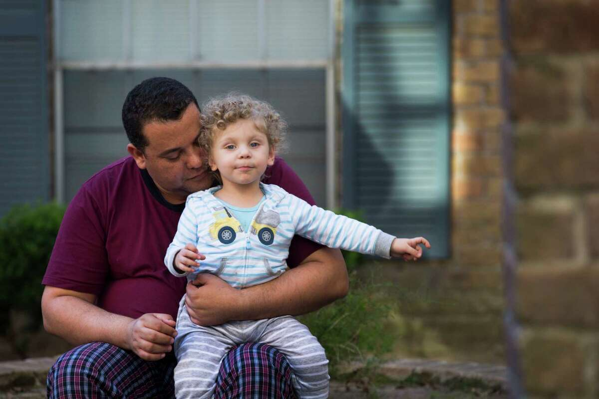 Haitham Alkhfe, 42, holds his one-year-old son Hamzah Alkhfe for a portrait outside their apartment in Houston, Monday, Jan. 30, 2017. Alkhfe brought his wife and son to Houston from their home in Iraq where worked for an American oil company and as a translator for the U.S. Army. Alkhfe who has a green card, says he was financially successful, but his family was not safe in Iraq. ( Marie D. De Jesus / Houston Chronicle )