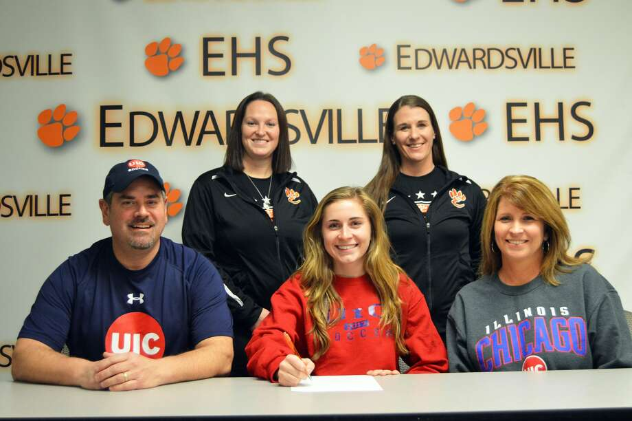 EHS senior Ashlin West, seated center, will play women's soccer at UIC. Seated next to her are parents Mike, left, and Angie. EHS head coach Abby Comerford, left, and assistant coach Abby Federmann are standing.