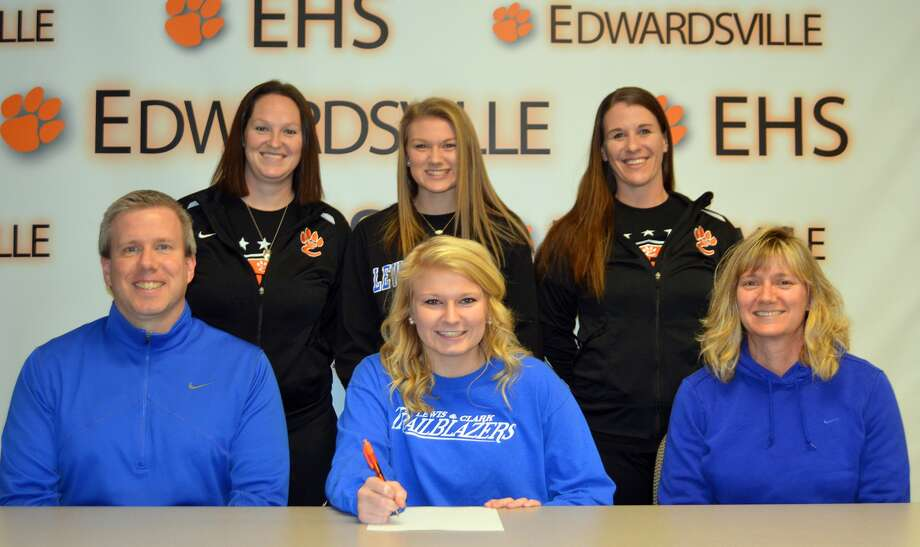EHS senior Taylor Hansen, seated center, will play women's soccer at LCCC. Seated are her parents, Jeff, left, and Michelle. Standing from left to right are EHS coach Abby Comerford, sister Casey Hansen and EHS assistant coach Abby Federmann.