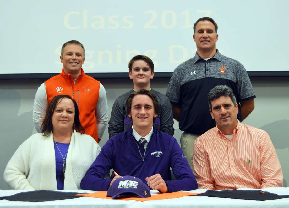 EHS senior Brenden Dickmann, seated center, will play football at McKendree. Seated next to Dickmann are parents, Cheri, left, and Brian. Standing are EHS QB coach Jason Osborn, left, Colten Dickmann and EHS coach Matt Martin.