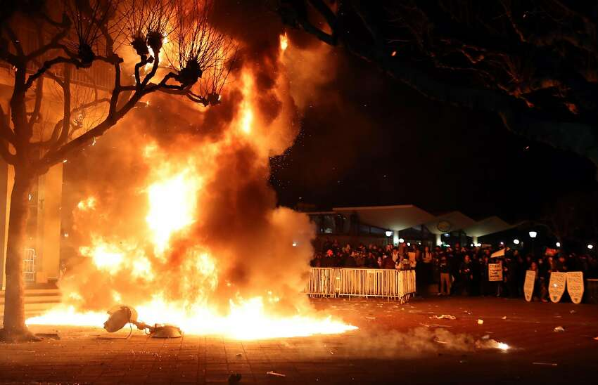 A portable light unit burns after demonstrations forced the cancellation of a talk by right-wing provocateur Milo Yiannopoulos in Berkeley, Calif., on Wednesday, February 1, 2017.