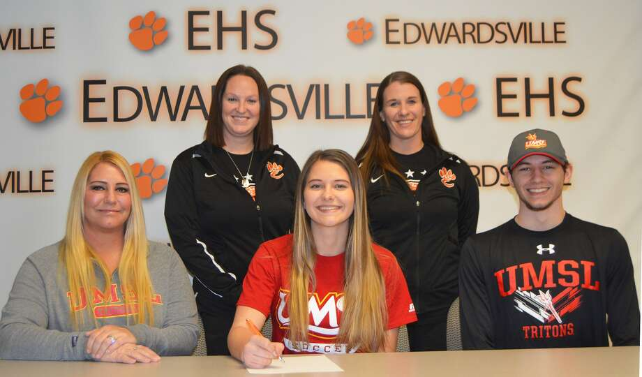 EHS senior Allysiah Belt, seated center, will play women's soccer for UMSL. Seated next to her is her mom, Tracie, and her brother, Gaige. Standing are EHS coach Abby Comerford, left, and EHS assistant coach Abby Federmann.