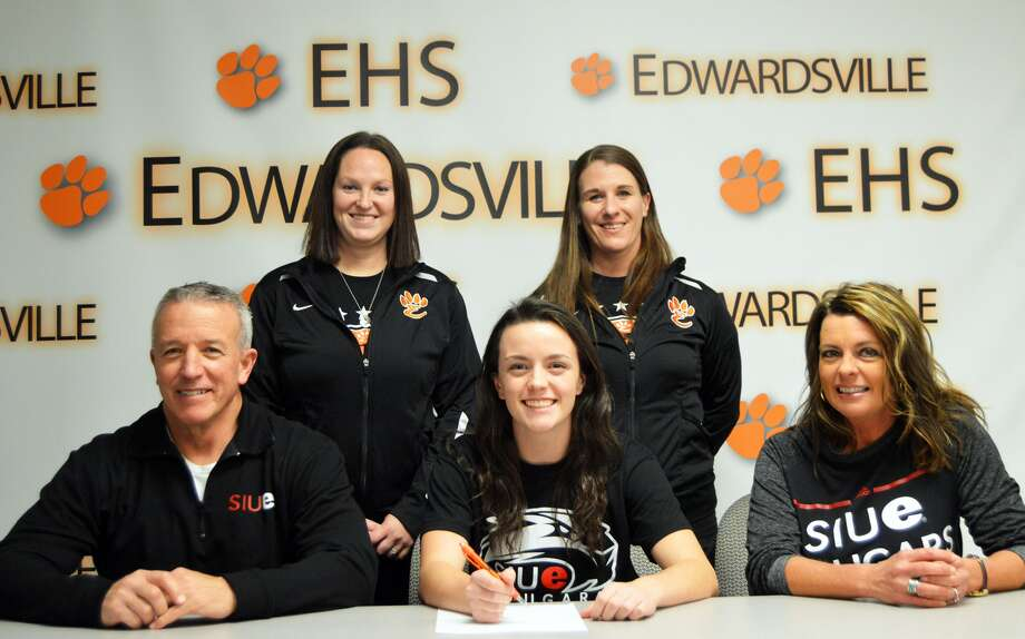 EHS senior Mallory Mushill, seated center, will play soccer for SIUE. Seated next to her are her parents, Paul, left, and Beth Ann. Standing are EHS coach Abby Comerford, left, and EHS assistant coach Abby Federmann.