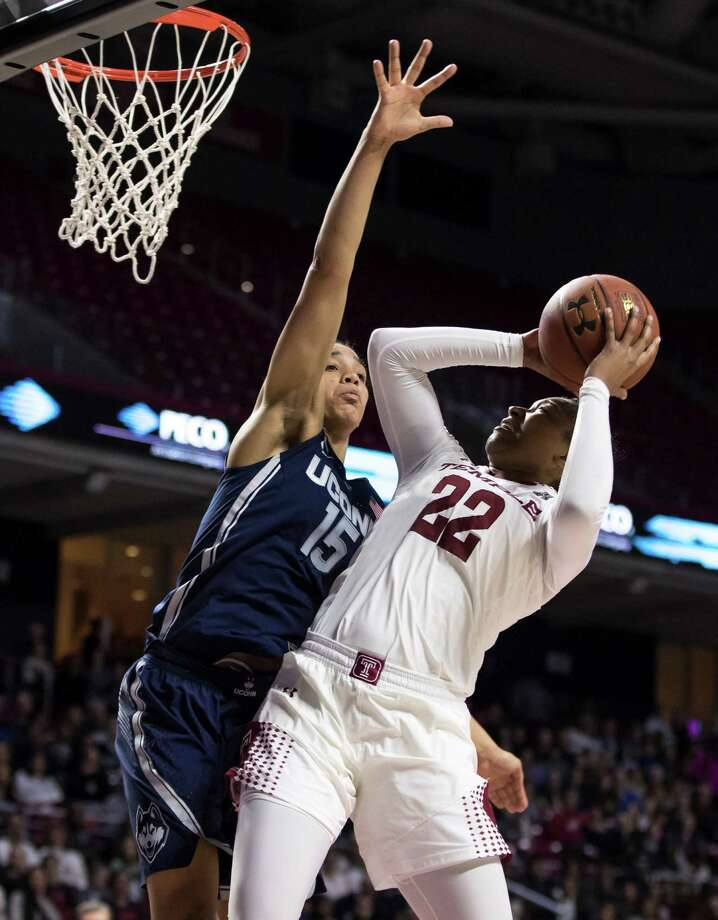 Connecticut's Gabby Williams, left, defends the basket agains the shot by Temple's Tanaya Atkinson, right, during the first half of an NCAA college basketball game, Wednesday, Feb. 1, 2017, in Philadelphia. (AP Photo/Chris Szagola) ORG XMIT: PACS105 Photo: Chris Szagola / FR170982 AP