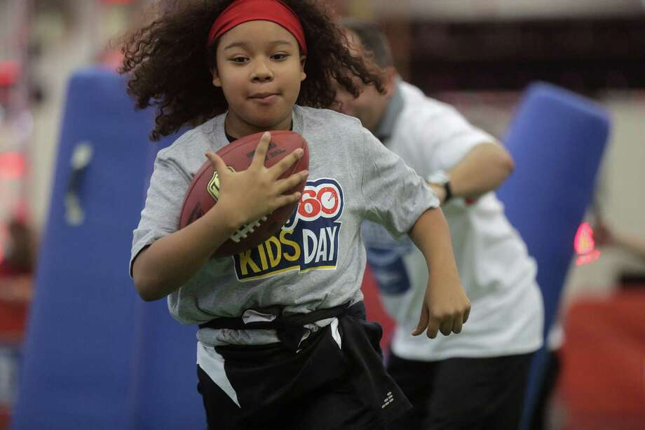 Samantha Bentancur, 10, makes her way through an obstacle course at the NFL Experience as part of the NFL Play 60  challenge on  Wednesday. Photo: Elizabeth Conley, Staff / © 2017 Houston Chronicle