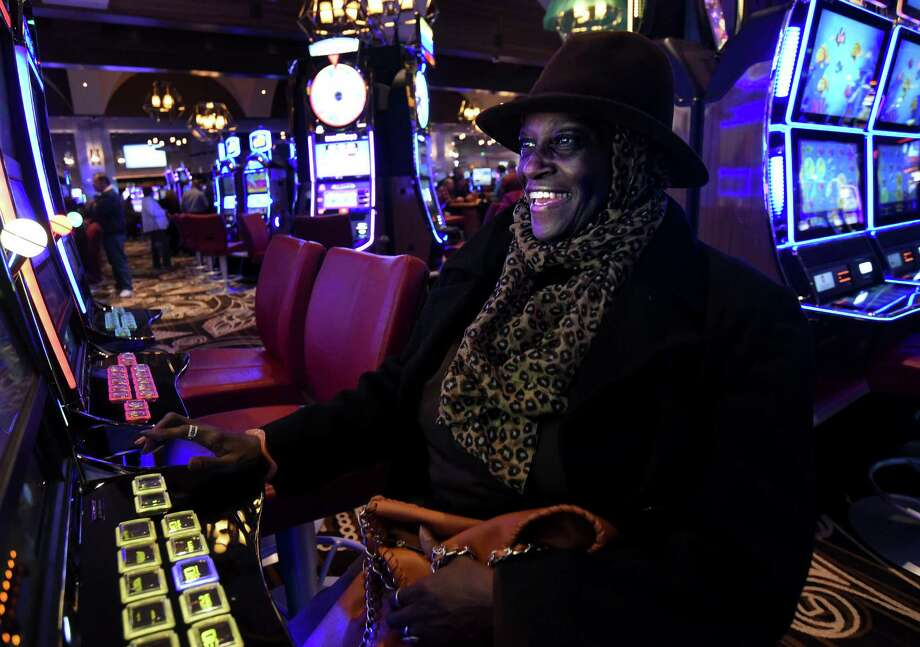 Vida Lowry tries her luck at the slot machines on opening day at del Lago Resort and Casino in Waterloo, N.Y., Wednesday, Feb. 1, 2017.  Thousands of new slot machines and table games debuting this month as part of New York state's casino growth spurt are bringing not only more chances to gamble, but also millions of dollars more to help problem gamblers.  (Kevin Rivoli/The Citizen via AP) ORG XMIT: NYAUB101 Photo: Kevin Rivoli / The Citizen