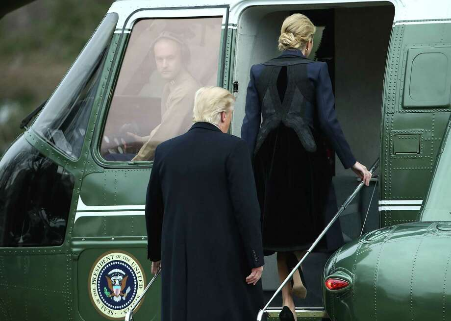 "WASHINGTON, DC - FEBRUARY 01:  U.S. President Donald Trump and his daughter Ivanka Trump walk toward Marine One while departing from the White House, on February 1, 2017 in Washington, DC. Trump is making an unnanounced trip to Dover Air Force bace in Delaware to pay his respects to Chief Special Warfare Operator William ""Ryan"" Owens, who was killed during a raid in Yemen. Owens is the first active military service member to die in combat during Trump's presidency. (Photo by Mark Wilson/Getty Images) ORG XMIT: 696365943 Photo: Mark Wilson / 2017 Getty Images"