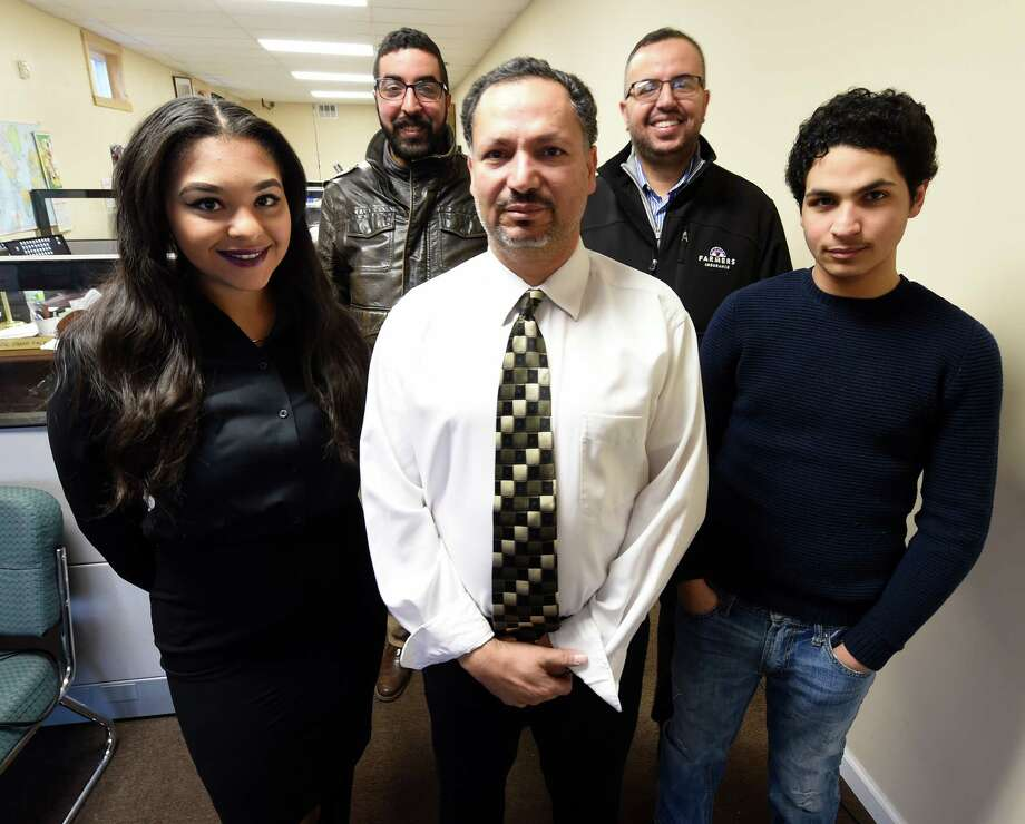 Nabeel Shohatee stands with his business associates;  Atry Moats, Albany Intern;  Ibrahim Fala, Adil Fala and Mahmoud Shohatee March 25, 2016, in Schenectady, N.Y.    (Skip Dickstein/Times Union) Photo: SKIP DICKSTEIN / 20035955A
