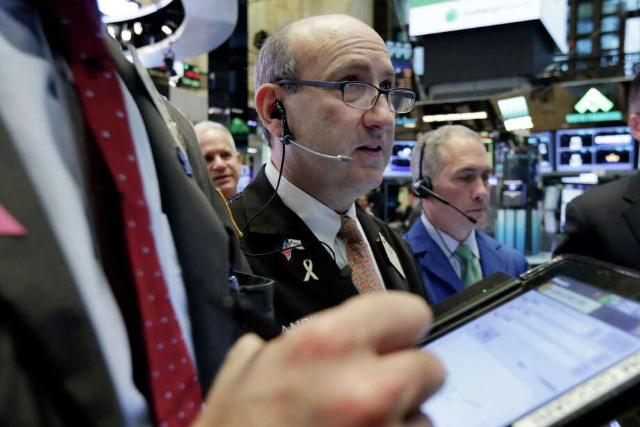 Trader Andrew Silverman, center, works on the floor of the New York Stock Exchange, Wednesday, Feb. 1, 2017. Solid Chinese manufacturing data helped shore up global stock markets on Wednesday ahead of the latest policy decision from the U.S. Federal Reserve. (AP Photo/Richard Drew) ORG XMIT: NYRD101 Photo: Richard Drew / AP