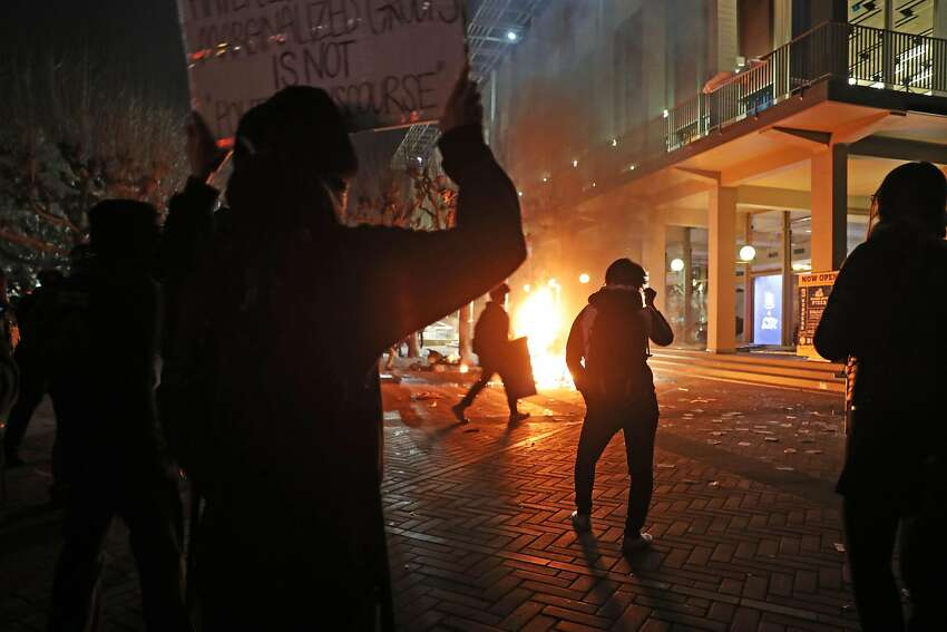 Demonstrators force the cancellation of talk by right-wing provocateur Milo Yiannopoulos in Berkeley, Calif., on Wednesday, February 1, 2017.