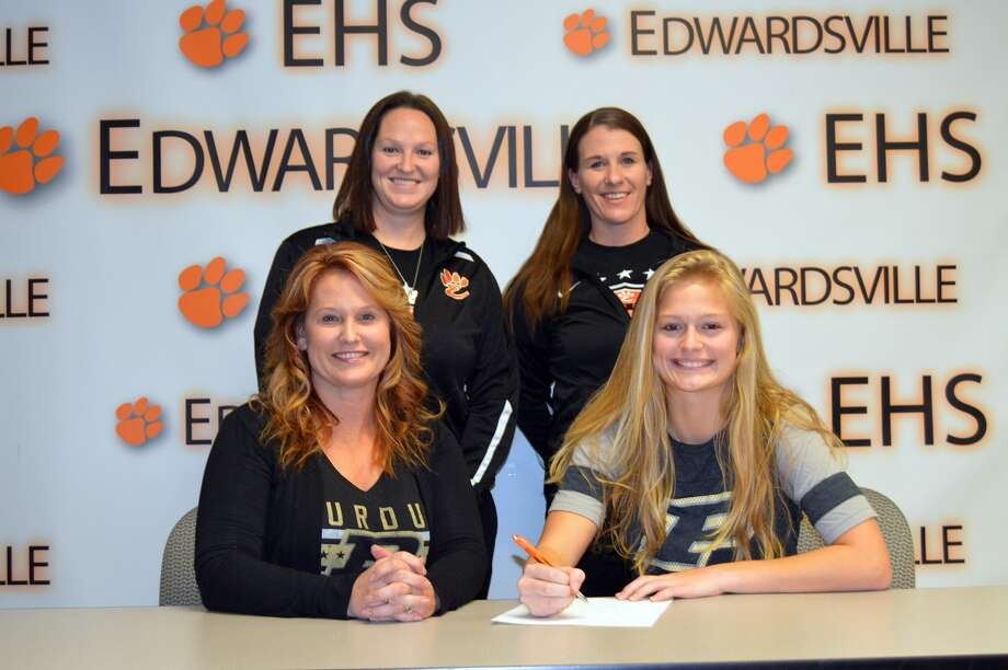 EHS senior Abby Crabtree, seated right, will play soccer at Purdue. Seated next to her is her mom Felicia. Her dad, Traves, is not pictured. Standing are EHS coach Abby Comerford, left, and EHS assistant coach Abby Federmann.