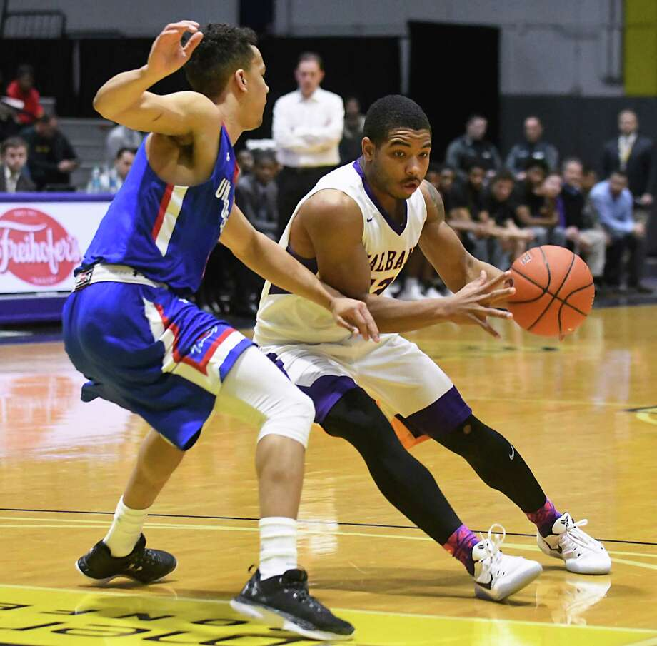 UAlbany's David Nichols is defended by UMass Lowell's Ryan Jones during a basketball game on Wednesday Feb. 1, 2017 in Albany, N.Y. (Lori Van Buren / Times Union) , Photo: Lori Van Buren / 20039505A