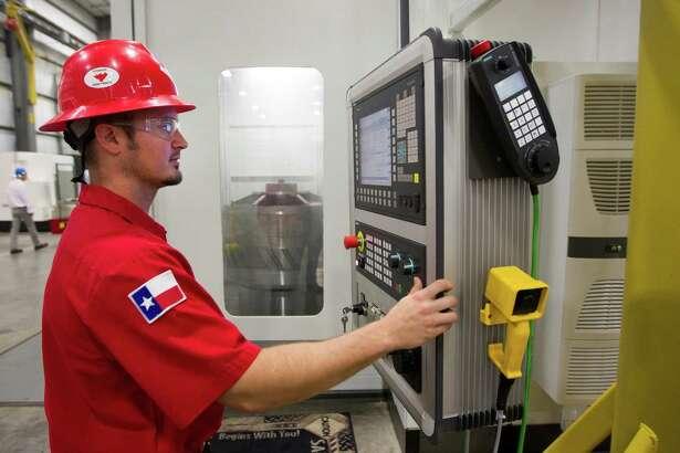 Derek Kolafa runs a Mag gear hobber at the Weatherford rod-pump manufacturing plant Thursday, June 26, 2014, in Katy. ( Brett Coomer / Houston Chronicle )