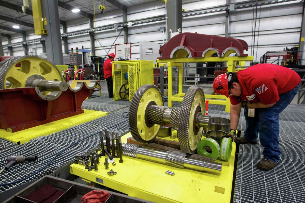 Stephan Finch works with gears at the Weatherford rod-pump manufacturing plant Thursday, June 26, 2014, in Katy. ( Brett Coomer / Houston Chronicle )