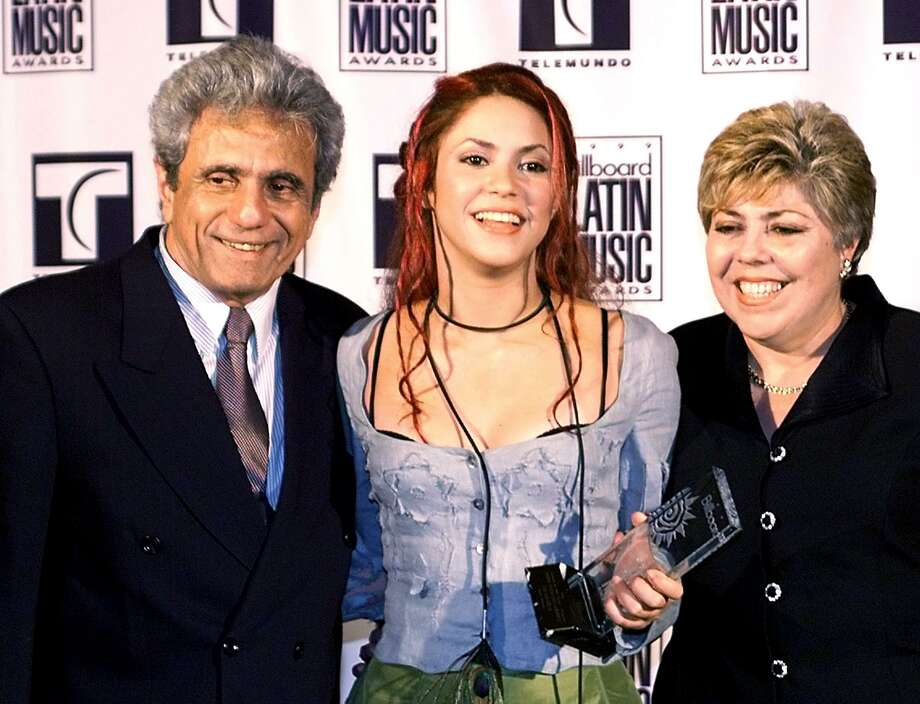1999: Shakira, center, poses with her parents at the Billboard Latin Music Awards on April 22, 1999, at the Fountainebleau Hotel on Miami Beach, Fla., after winning the award for Pop Album of the Year. Photo: ROBERTO SCHMIDT/AFP/Getty Images
