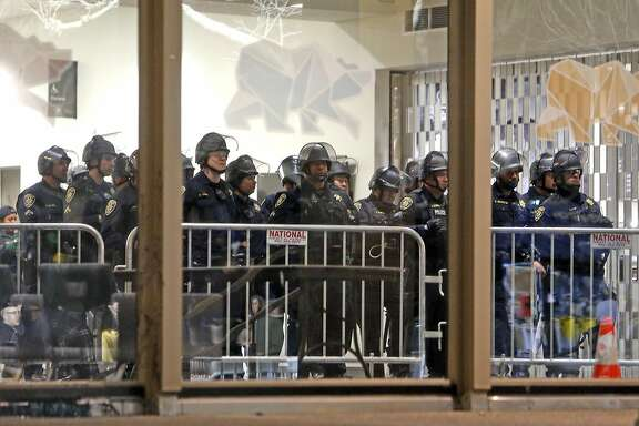Berkeley Police stand inside the Student Union as demonstrators force the cancellation of a talk by right-wing provocateur Milo Yiannopoulos in Berkeley, Calif., on Wednesday, February 1, 2017.