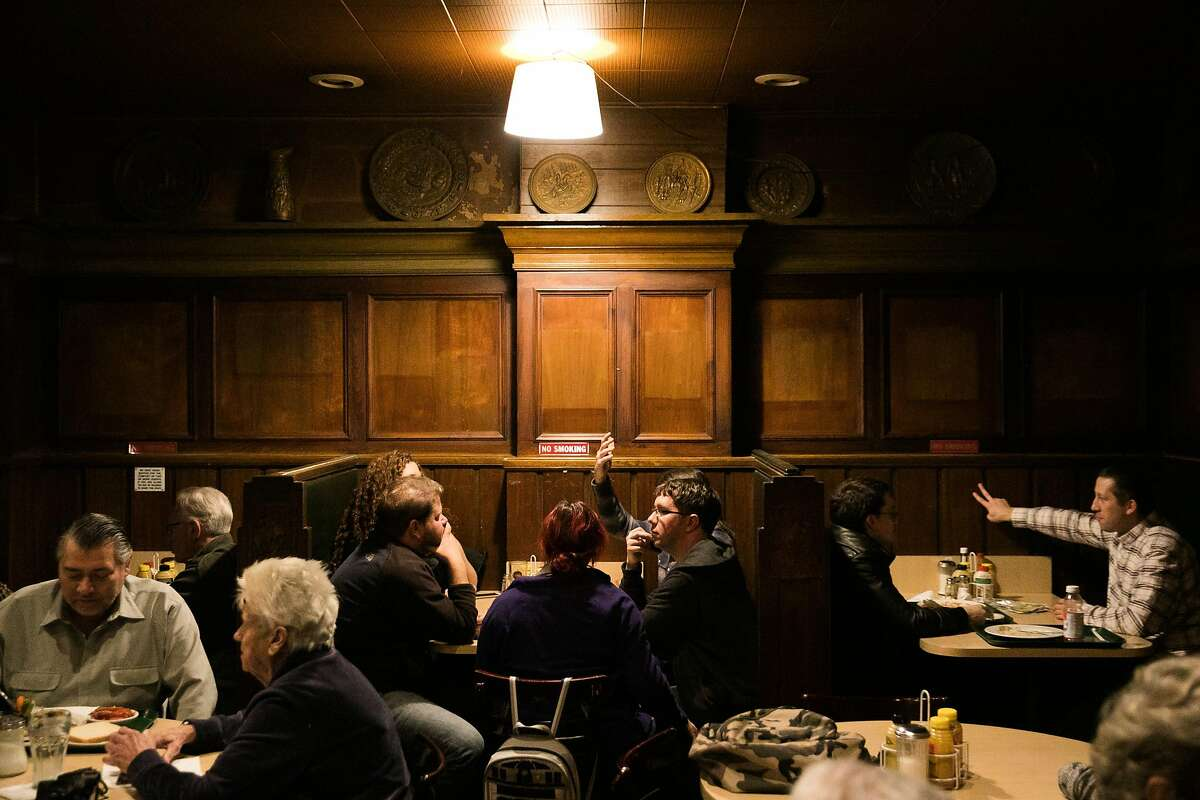 The bare walls are seen at Lefty O'Doul's Restaurant & Cocktail Lounge as people gather for one last meal and drink at the 333 Geary Street location in San Francisco, Calif., Monday, February 01, 2017.