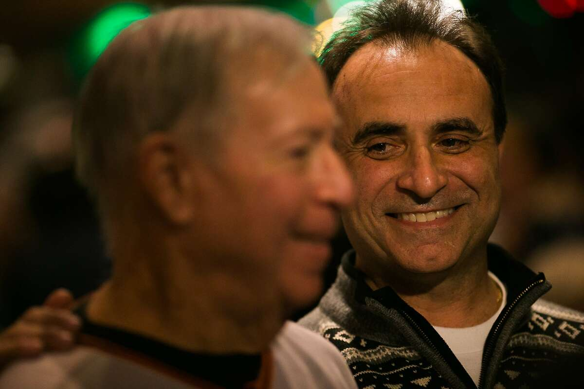 Nick Bovis hugs Tom O'Doul, cousin of bar namesake Lefty O'Doul, at their final party at the 333 Geary Street location in San Francisco, Calif., Monday, February 01, 2017. Nick Bovis, proprietor of Lefty O'Doul's, plans to move the restaurant and the memorabilia to a new location by late fall.
