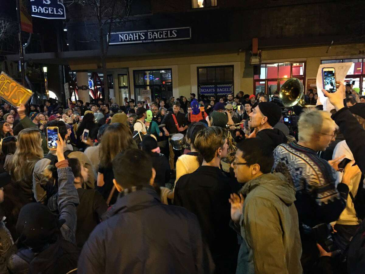 Protesters leave the UC Berkeley campus and head down Telegraph Ave. as groups move through city streets.
