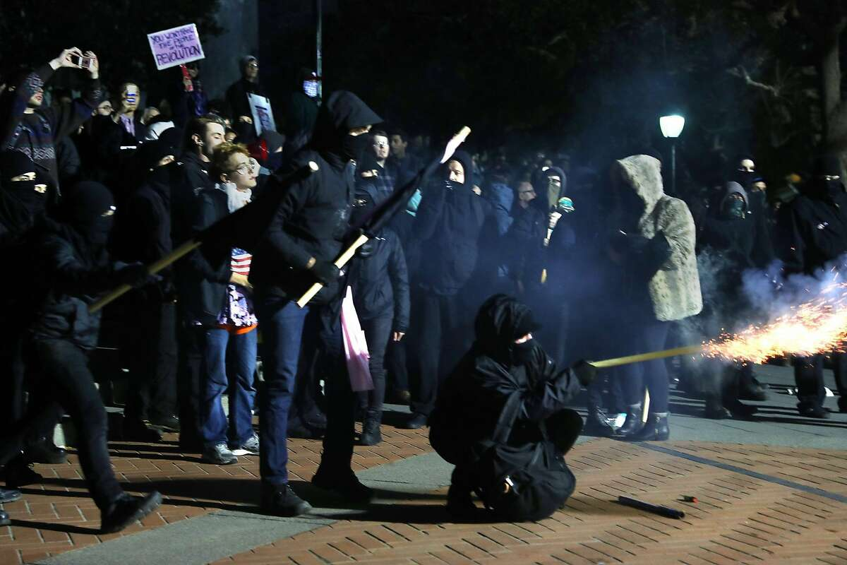 Members of the Black Bloc shoot fireworks at the UC Berkeley Student Union forcing the cancellation of a talk by right-wing provocateur Milo Yiannopoulos in Berkeley, Calif., on Wednesday, February 1, 2017.