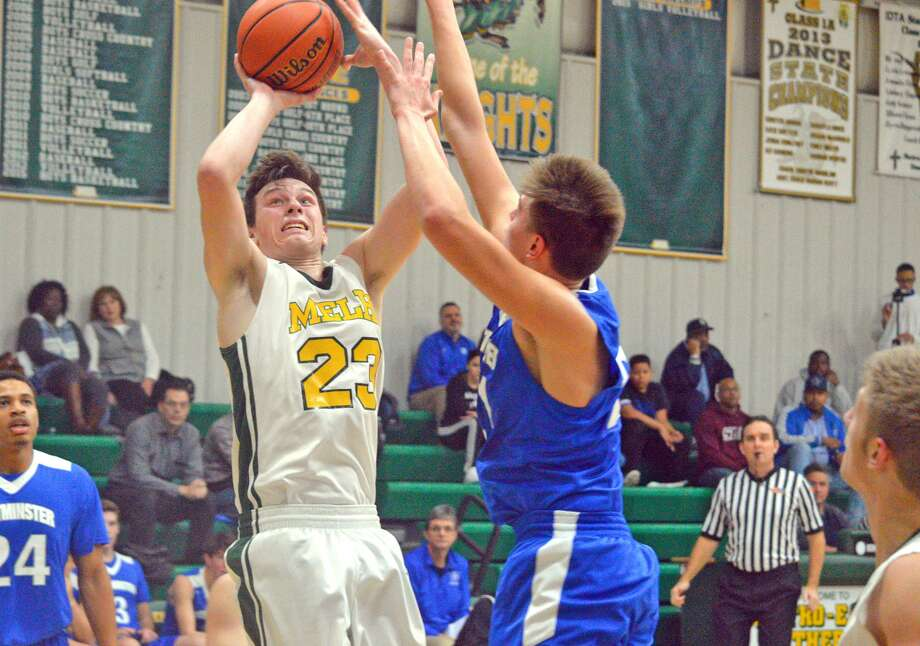 Metro-East Lutheran senior Braden Woolsey puts up a shot during the second quarter of Wednesday's home game against Westminster Christian Academy.