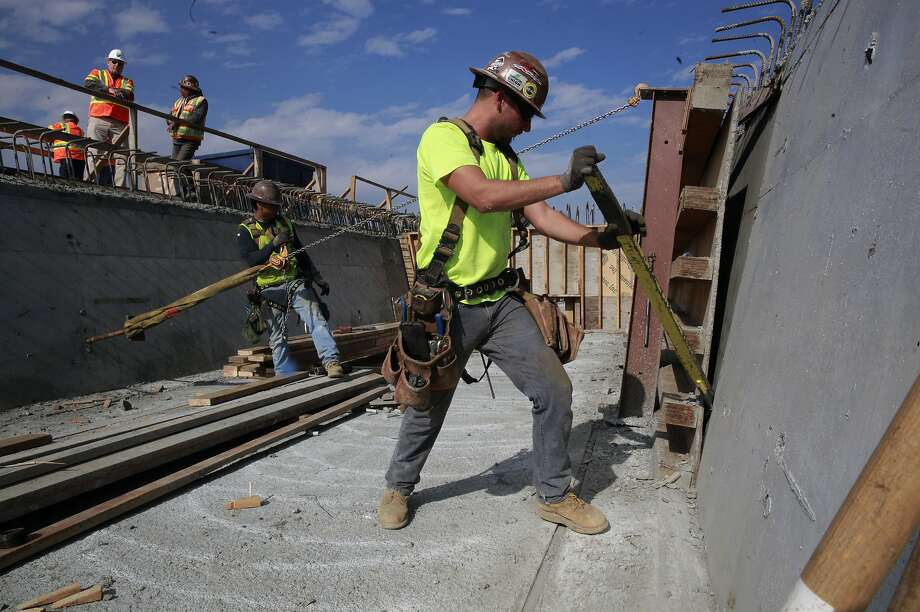 Anthony Garcia and fellow workers on an elevated section of tracks of the California high-speed rail system in Fresno, Ca., as seen on Wednesday Feb. 1, 2017. Photo: Michael Macor, The Chronicle
