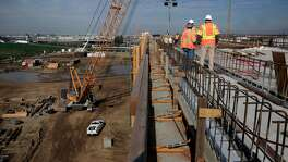 Workers on an elevated section of tracks for the high-speed rail system in Fresno, Ca., as seen on Wednesday Feb. 1, 2017.