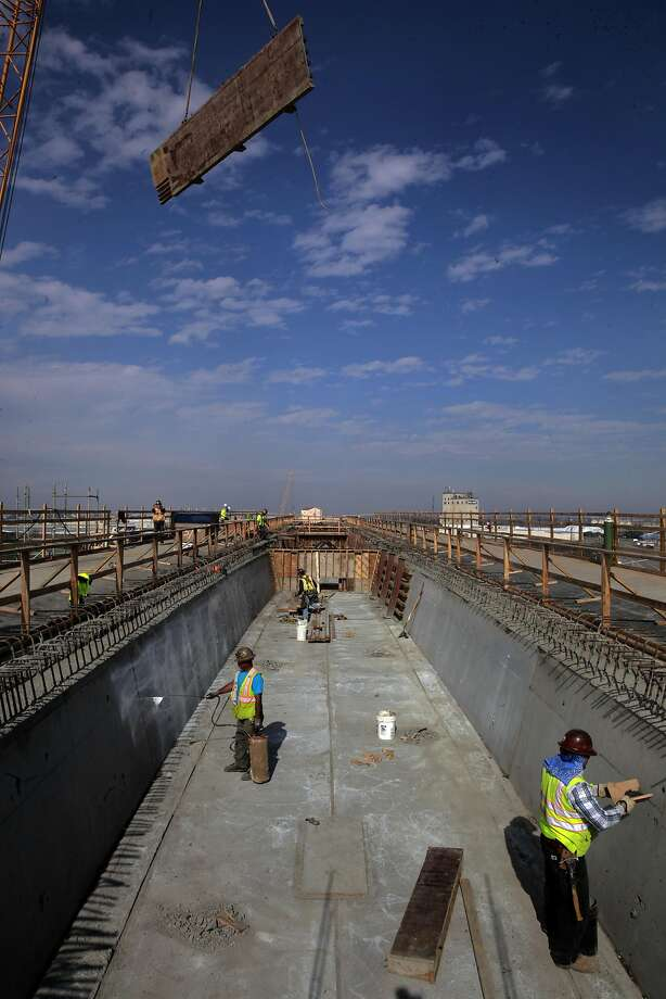 Work continues this month on a half-mile viaduct for the high-speed rail project just south of downtown Fresno. Photo: Michael Macor, The Chronicle