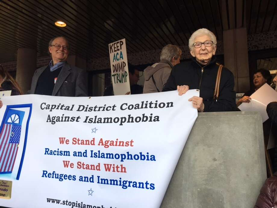 Sarah Gewirtzman Chapman, 87, holds a banner against Islamophobia with Steve Downs during the Women?s March in Albany on Jan. 21. This was her first protest and she was attending the march with her daughter Barbara Dworkin.