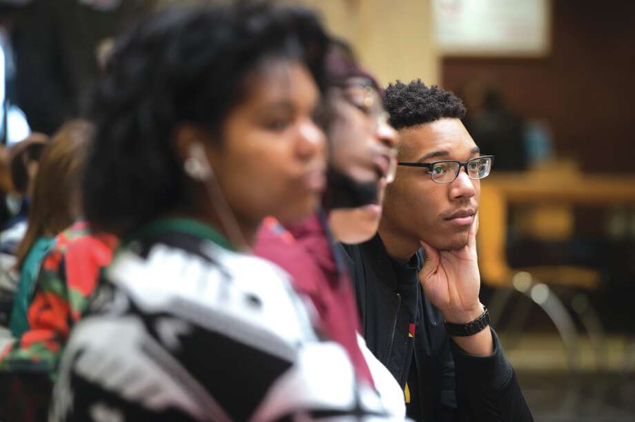 Belleville native Nick Givens, a sophomore studying psychology, listens intently to the featured presentations during the Black Heritage Month kickoff celebration at SIUE.