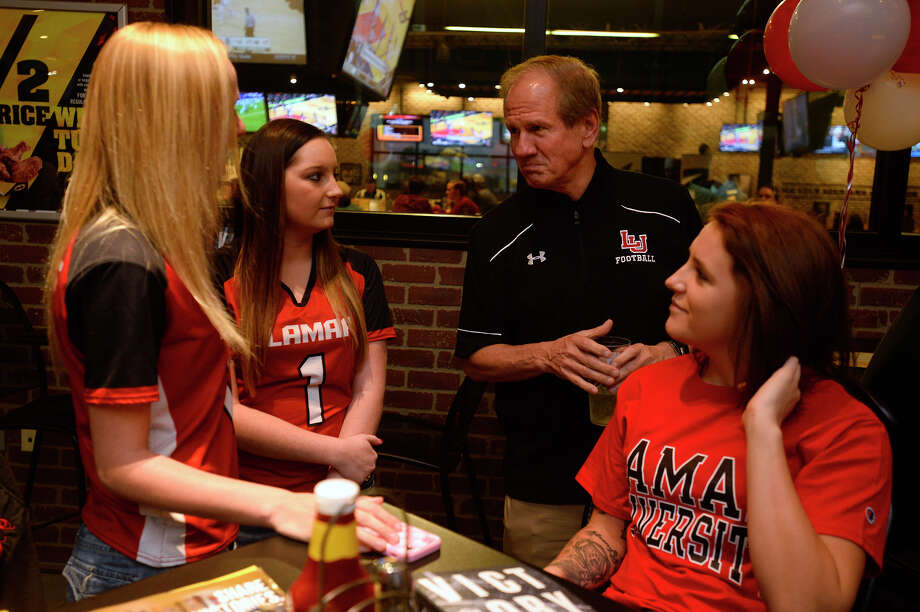 Lamar head football coach Mike Schultz talks with Shannon McClendon, Autumn Harris and Kaylee Harding at Buffalo Wild Wings on Wednesday night. The event gave Cardinal Club members an opportunity to meet the coaches and learn about their recruiting class after National Signing Day.  Photo taken Wednesday 2/1/17 Ryan Pelham/The Enterprise Photo: Ryan Pelham / ©2017 The Beaumont Enterprise/Ryan Pelham