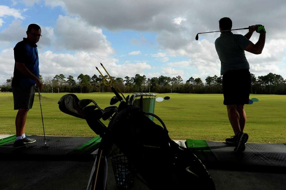 Dave Drummond, left, and Eric Bridwell practice hitting golf balls at the Games People Play driving range on Wednesday. A developer is considering building an apartment complex for low-income seniors on the property.  Photo taken Wednesday 2/1/17 Ryan Pelham/The Enterprise Photo: Ryan Pelham / ©2017 The Beaumont Enterprise/Ryan Pelham