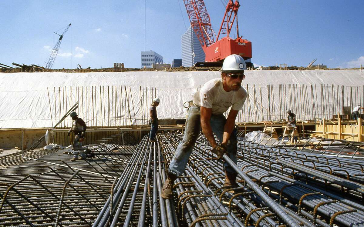In Sept. 1985 construction workers work on foundation of George R. Brown Convention Center.