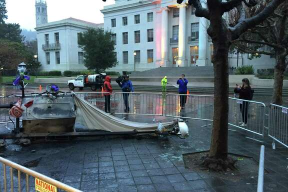 A light stand in front of the Martin Luther King Jr. Student Union at UC Berkeley was toppled over and set on fire by protesters Wednesday night.