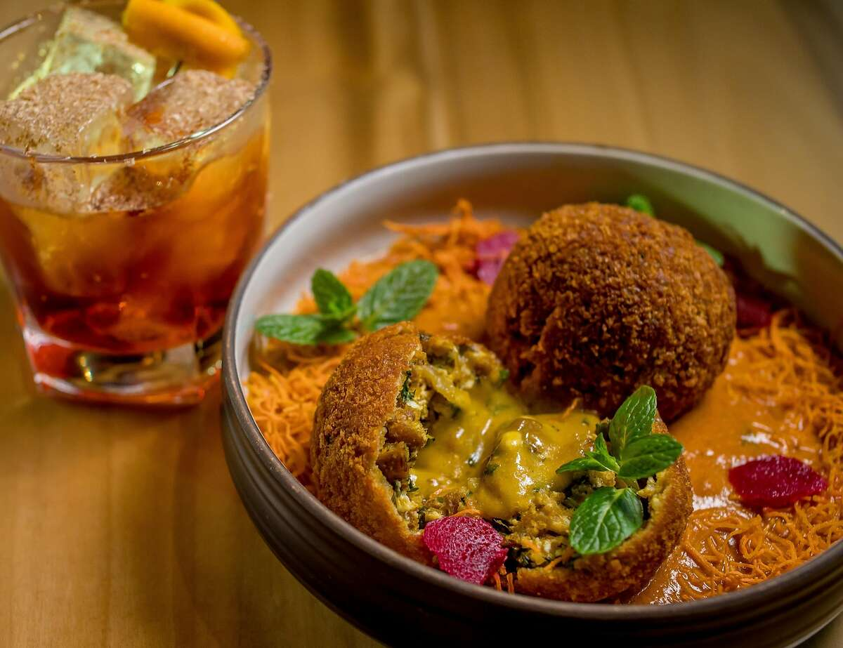August (1) Five Cuisine: Contemporary Indian Owner Hetal Shah worked in advertising technology at Google before opening her first restaurant with August (1) Five. Pictured are soy meatballs coated in chickpea batter and breadcrumbs, fried, served on crisp sweet potato threads and a tomato, fenugreek and watermelon seed sauce. The name of the restaurant commemorates the date India gained independence from British rule. 524 Van Ness Ave., San Francisco