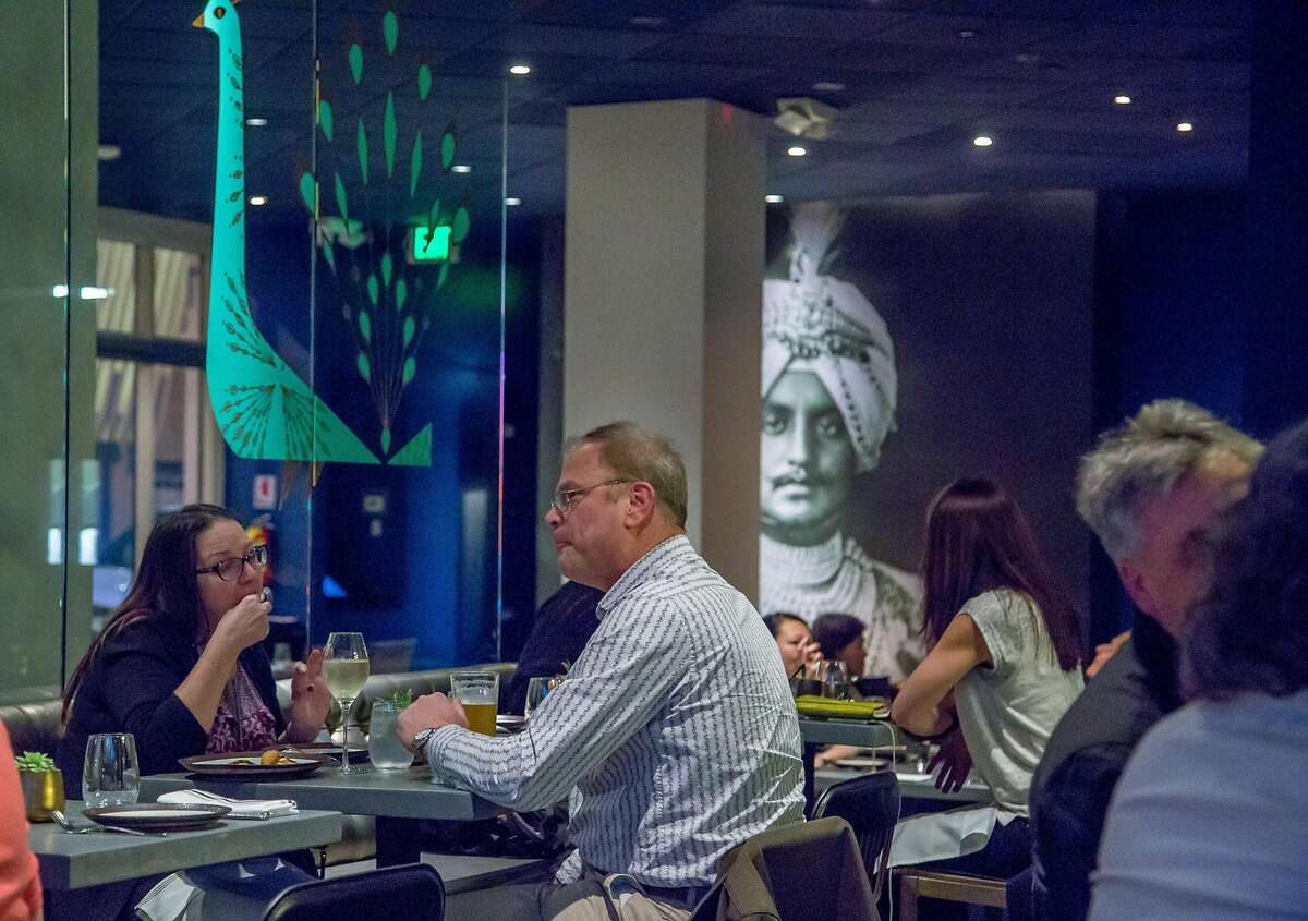People have dinner in the bar at August 1 Five in S.F.