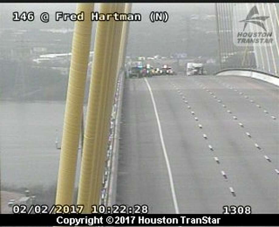 Texas 146 was shut down about 9:50 a.m. Thursday, Feb. 2, 2017, at the Fred Hartman Bridge after a person threatened to jump from the span in east Harris County. (Houston TranStar)