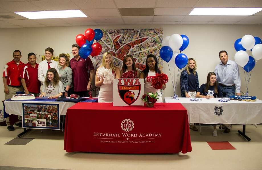 Incarnate Word Academy's Lily Hatcher and Lauren Zammit signed letters of intent on Wednesday. Hatcher signed to play softball at Lee University, and Zammit signed to run cross country at the University of Dallas. Photo: Incarnate Word Academy