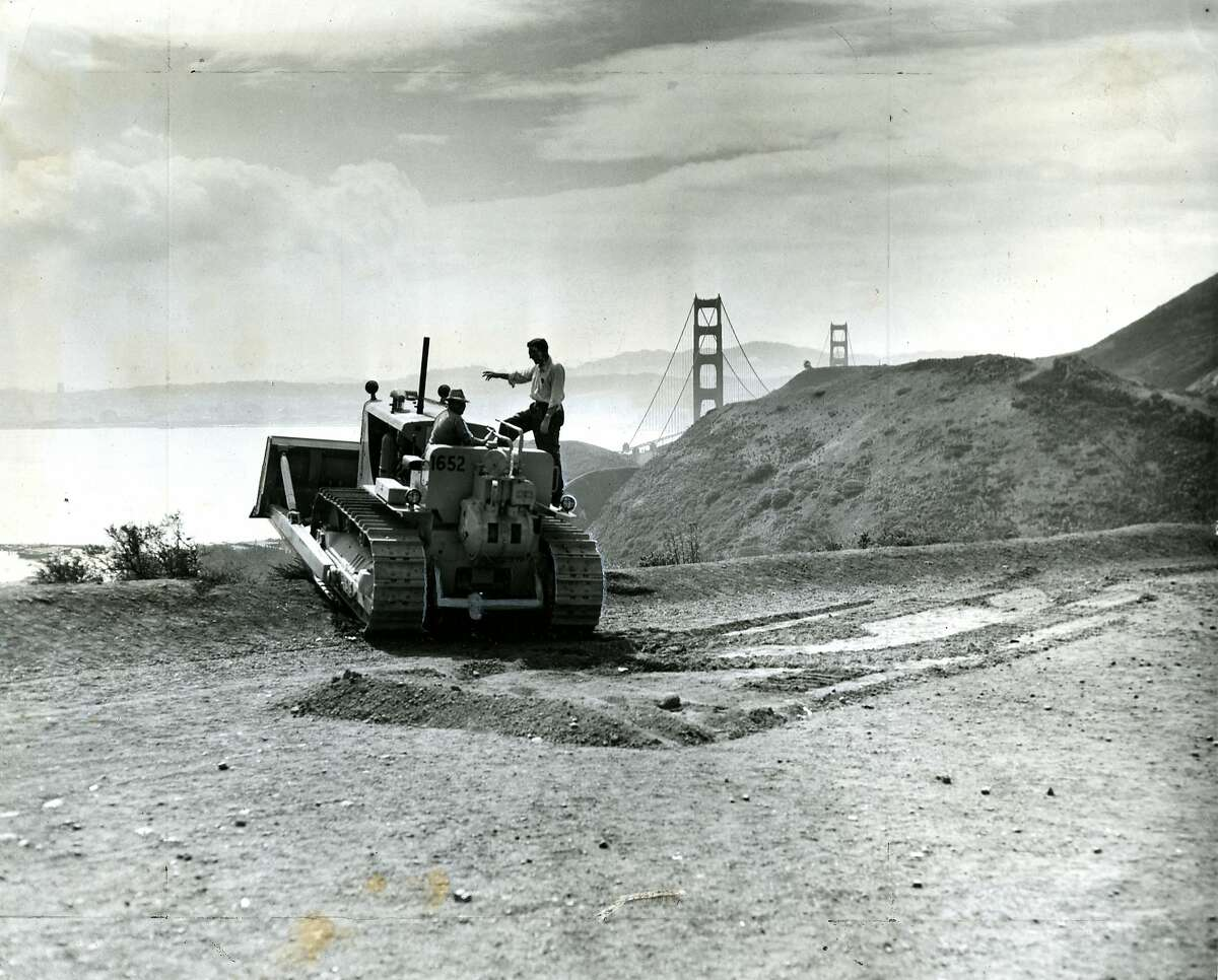 September 23, 1953: Ground was broken for what was the largest single highway contract in California history at that time, for the four mile Waldo freeway approach to the Golden Gate Bridge in Marin County. In the photo are, Troy Harwell, heavy equipment operator and George McCoy, Jr, general superintendent. The Waldo (Robin Williams) Tunnel was on the east side or second bore. In 1937 first bore was two lanes and the ONLY tunnel along Hwy. 1 link from Marin City to San Francisco, outside of winding through the streets of Sausalito. The photo is about the second bore. That project started in 1953 creating a second tunnel so that traffic flowed north through the new tunnel and south through the original tunnel.