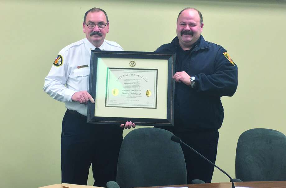 Edwardsville Fire Chief Rick Welle awarded Captain James Whiteford his diploma after successfully completing his training at the National Fire Academy. Whiteford completed the Executive Fire Officer program and finished strong in the fire administration trainings as well. Photo: Cody King • Intelligencer