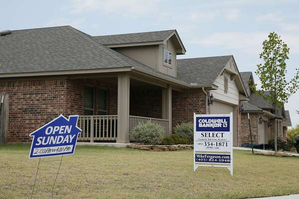 This Wednesday, July 27, 2016, photo shows real estate signs at a new home community in Edmond, Okla. On Thursday, Feb. 2, 2017, Freddie Mac reports on the week's average U.S. mortgage rates. (AP Photo/Sue Ogrocki)