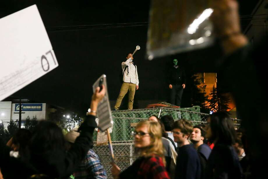 People protesting controversial Breitbart writer Milo Yiannopoulos march in the street on Wednesday night in Berkeley. Photo: Elijah Nouvelage, Getty Images