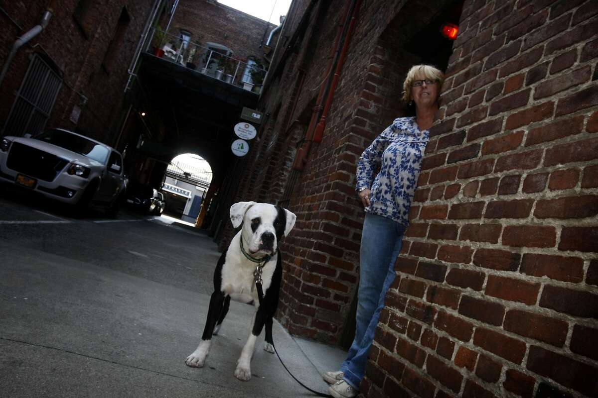 Dawn Holliday, booking agent for Slim's and the Hardly Strictly Bluegrass Festival coming up in October, with her puppy Joey in San Francisco, Calif., on Friday, August 7, 2009.