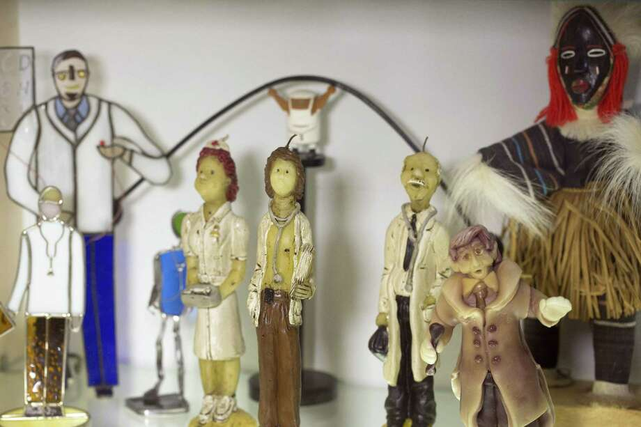 Braverman's eclectic doctor figurine collection features pieces from all over the world. Photo: Ray Whitehouse /For The San Antonio Express-News / San Antonio Express-News