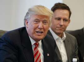 FILE - In this Wednesday, Dec. 14, 2016, file photo, PayPal founder Peter Thiel, right, listens as then President-elect Donald Trump speaks during a meeting with technology industry leaders at Trump Tower in New York. Thiel was able to gain New Zealand citizenship in 2011 despite never having lived in the country because a top lawmaker decided his entrepreneurial skills and philanthropy were valuable, documents reveal. Thiel didn't even have to leave California to become a new member of the South Pacific nation. (AP Photo/Evan Vucci, File)