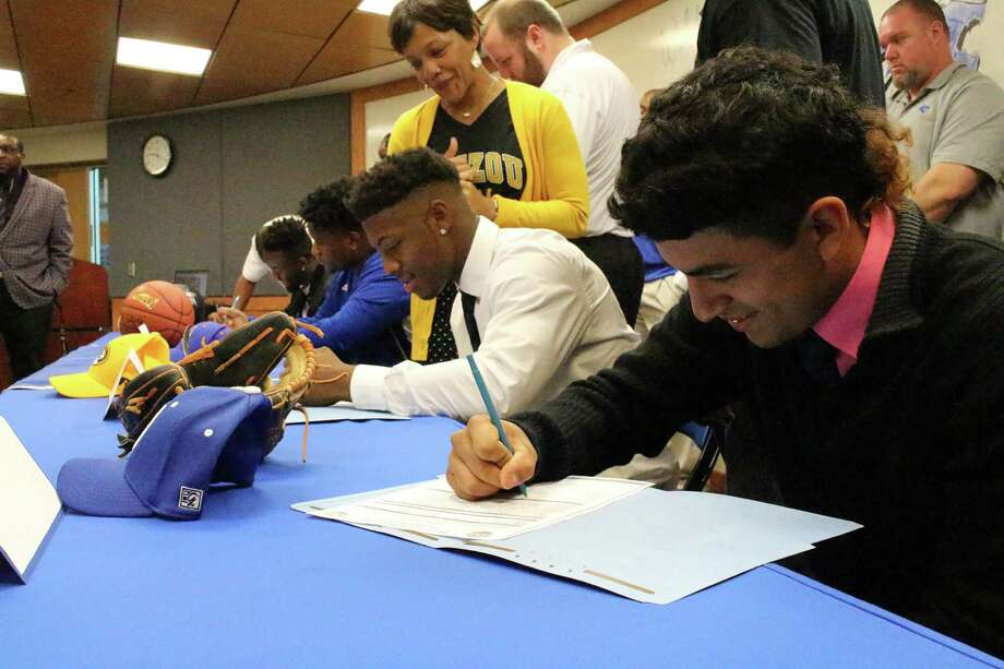 Dekaney High School student athletes, from left, Elliott Albert, from left, Bryce Cruz, Joshuah Bledsoe and José Galvé¡n sign letters of intent. Photo: Submitted