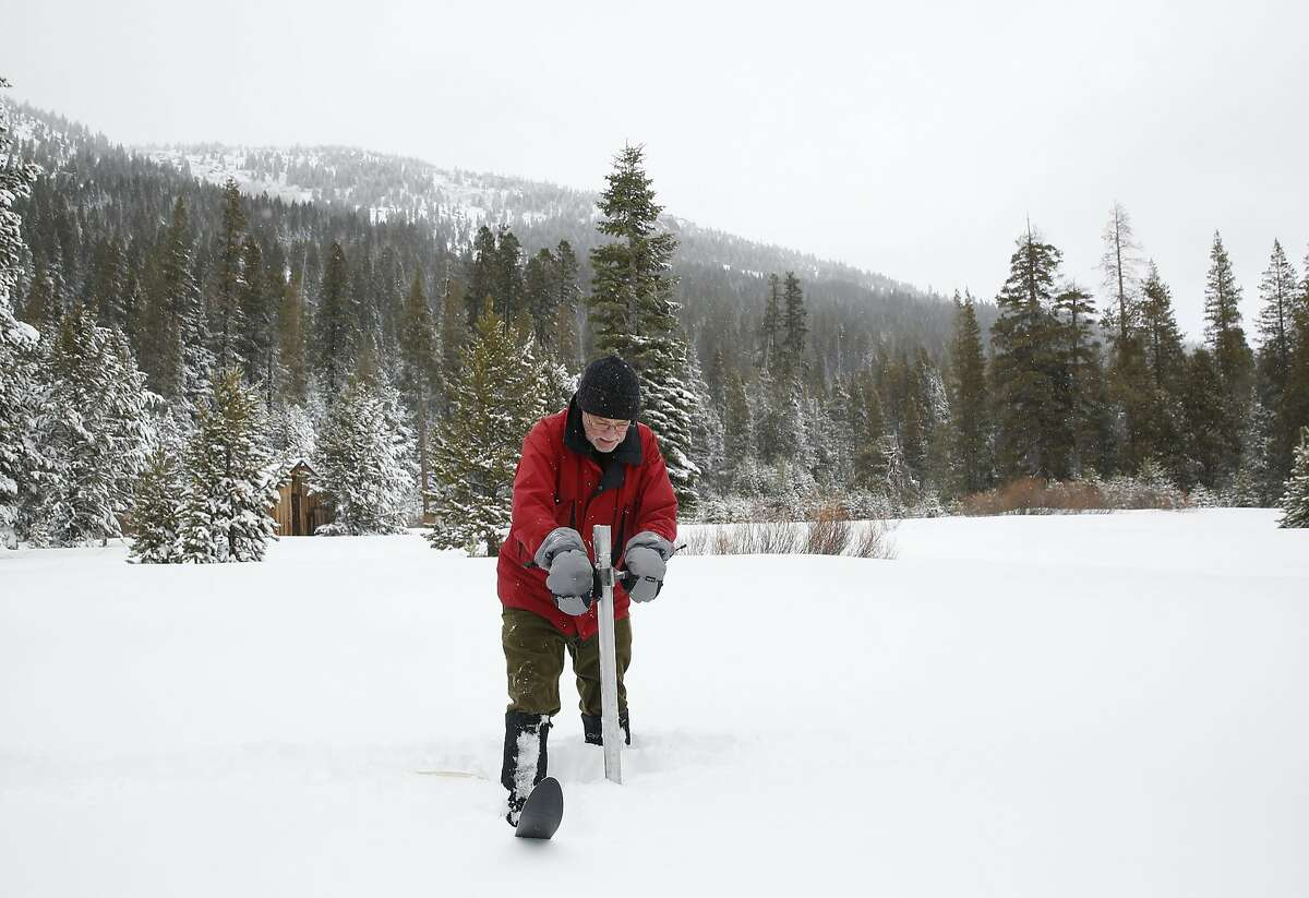 In this Jan. 3, 2017, file photo, Frank Gehrke, chief of the California Cooperative Snow Surveys Program for the Department of Water Resources, plunges the survey tube into the snowpack as he conducts the first snow survey of the season at Phillips Station near Echo Summit, Calif. Nothing but good news is expected when California does its next regular Sierra snow surveys after last month's huge storms. The state snow survey on Thursday, Feb. 2, 2017, is important because California gets about a third of its water from Sierra runoff in typical years.